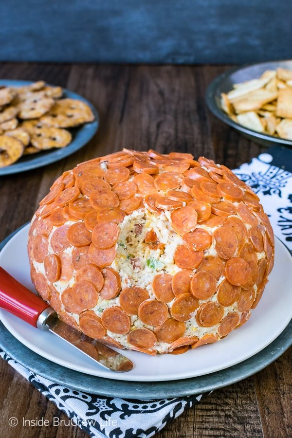 Loaded Pizza Cheese Ball - this easy appetizer is loaded with cheeses, meats, and veggies. Great recipe to share at football parties!