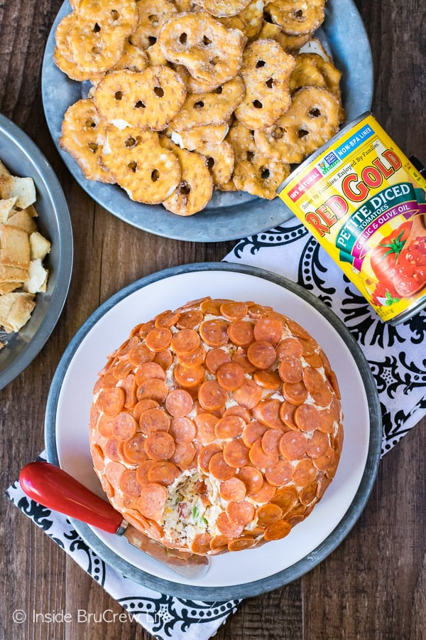 Loaded Pizza Cheese Ball - this easy appetizer is filled with your favorite pizza toppings. Great recipe to share at game day parties!
