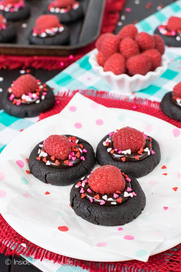 Chocolate Raspberry Thumbprint Cookies - a fudge center and raspberries make these little chocolate cookies so pretty and delicious. Easy recipe to make for Valentine's day parties. #cookies #chocolate #thumbprintcookies #raspberry #valentinesday