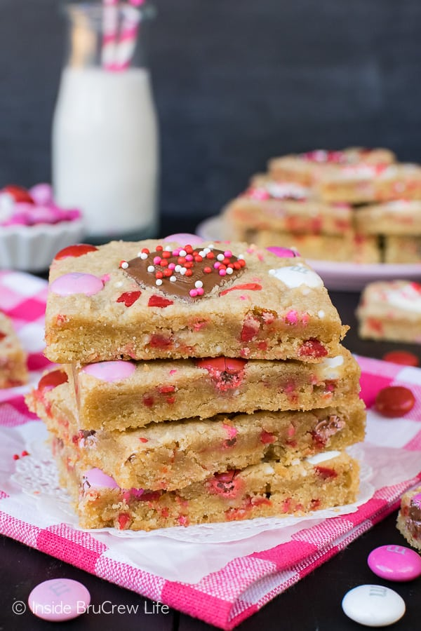 Valentine Peanut Butter Heart Cookie Bars - these easy cookies are made in a sheet pan and loaded with sprinkles and candies. Easy recipe for Valentine's day parties! #cookies #peanutbutter #peanutbutterhearts #valentine #valentinesdaytreats #cookiebars #dessert #reeses