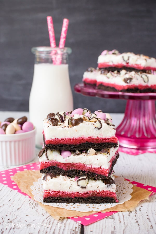 Neapolitan Sugar Cookie Bars - vanilla frosting and colored candies make these chocolate and strawberry cookies a fun dessert to make and eat. Great recipe to share at parties and picnics. #cookies #chocolate #strawberry #vanilla #sugarcookies #easydesserts #barcookies