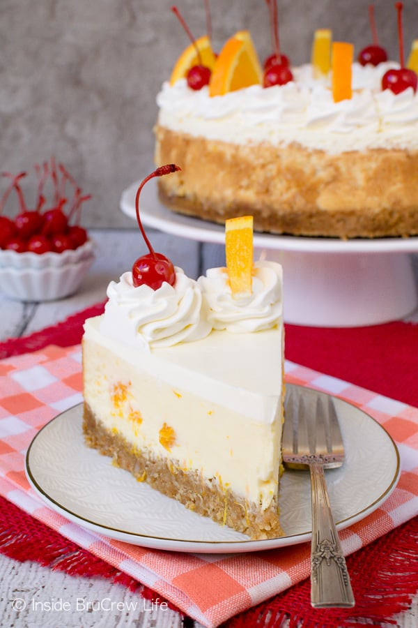 Orange Cream Cheesecake - orange juice and pieces add a great flavor to this easy and creamy cheesecake. This is an easy dessert recipe to share at spring or summer parties or picnics. #cheesecake #orange #macadamianuts #dessert #recipe #orange #spring #summer