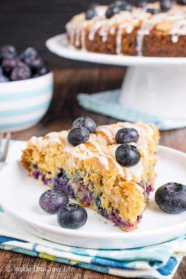Blueberry Orange Crumble Cake - this soft coffee cake is loaded with fresh blueberries and orange zest. The streusel and glaze give it a sweet topping. Make this easy recipe for breakfast or brunch. #coffeecake #blueberry #orange #breakfast #brunch #mothersday #homemade #recipe #easy