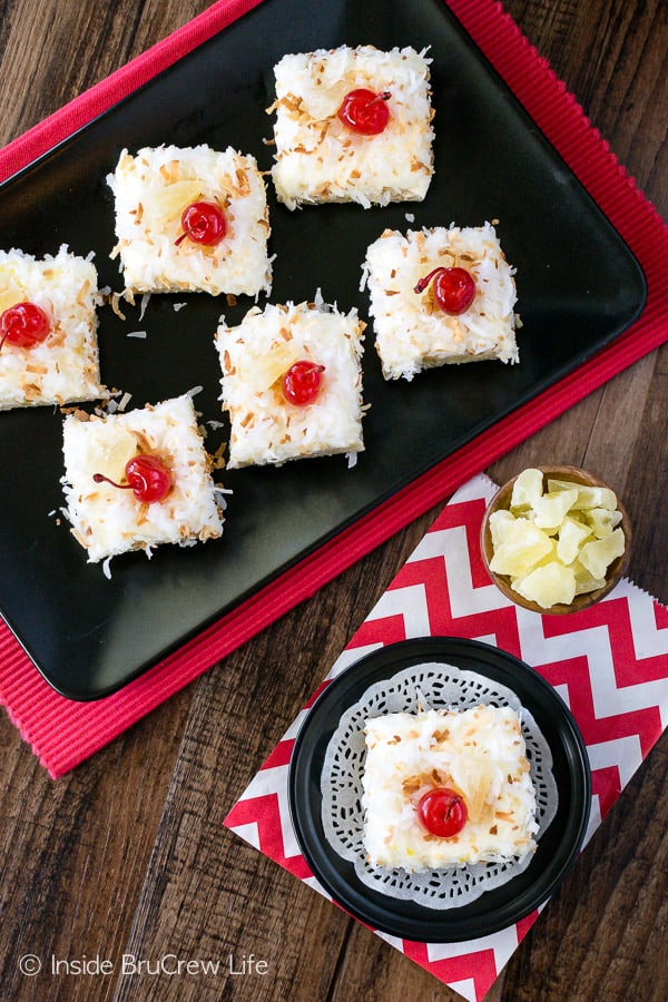 Pina Colada Sugar Cookie Bars - chewy sugar cookie bars loaded with coconut and topped with pineapple frosting makes a delicious tropical treat. Make this easy recipe for summer picnics or parties. #sugarcookiebars #easy #dessert #frosting #pinacolada #pineapple #coconut #barcookies #bakesale