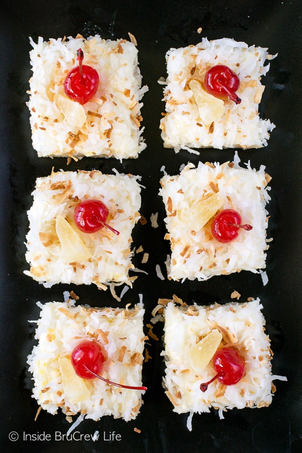 Pina Colada Sugar Cookie Bars - chewy coconut bars with a sweet pineapple frosting makes a delicious tropical dessert. Make this easy recipe for dessert or summer parties. #sugarcookiebars #easy #dessert #frosting #pinacolada #pineapple #coconut #barcookies #bakesale