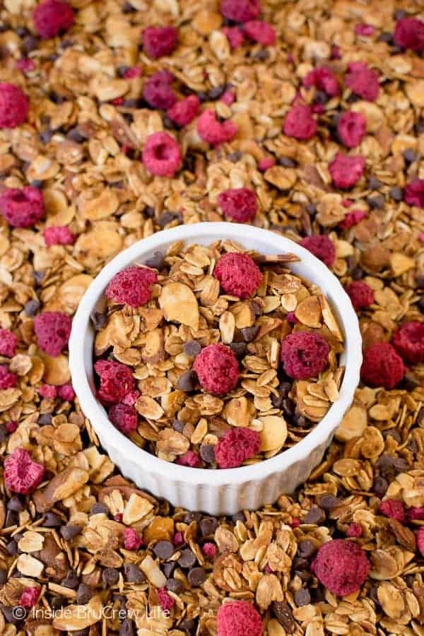 Raspberry Chocolate Chip Granola - this easy homemade granola is loaded with almonds, chocolate, and raspberries. Make this easy granola for cereal or parfaits. #breakfast #granola #homemade #raspberry #chocolate #cereal #parfaits #yogurt