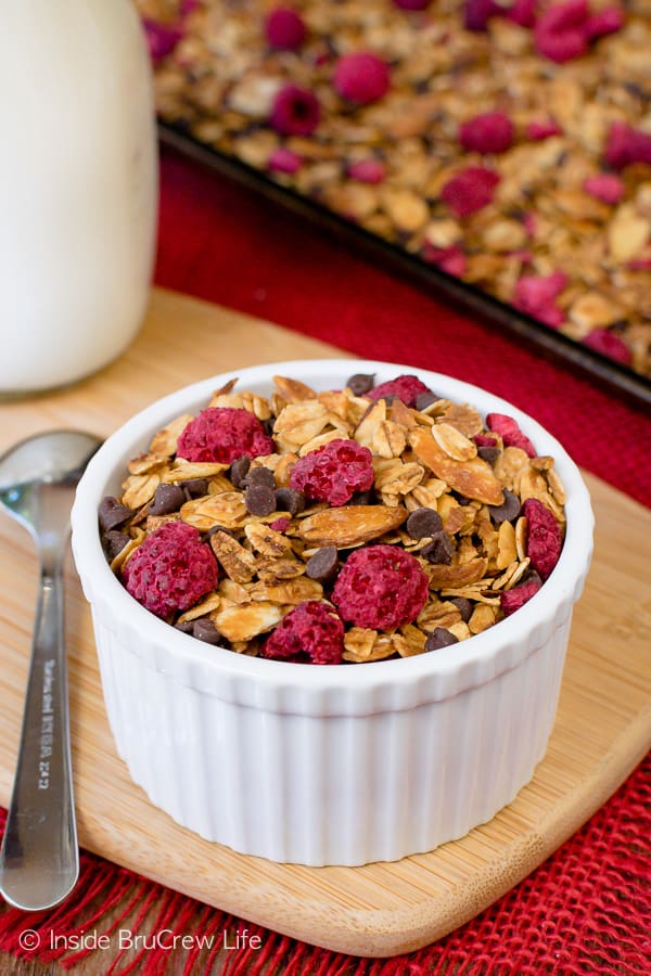 Raspberry Chocolate Chip Granola - homemade granola loaded with chocolate and raspberries makes a delicious cereal or yogurt parfait. Make this easy recipe to have on hand for munching. #breakfast #granola #homemade #raspberry #chocolate #cereal #parfaits #yogurt