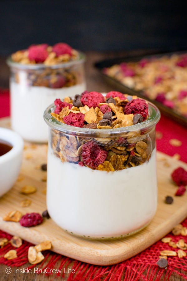 Raspberry Chocolate Chip Granola - this homemade granola is loaded with chocolate, almond, and raspberry crunch. Make this easy granola for cereal or yogurt parfaits. #breakfast #granola #homemade #raspberry #chocolate #cereal #parfaits #yogurt