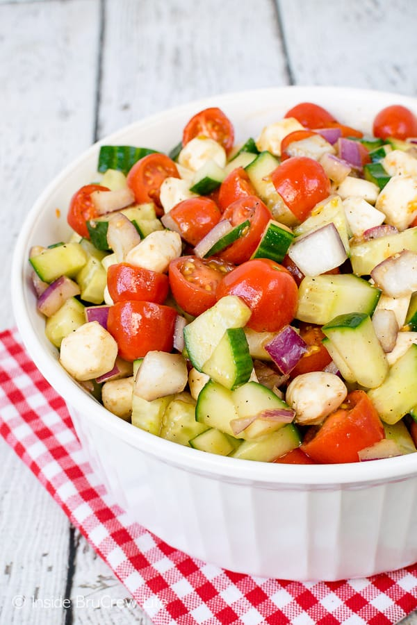 Balsamic Caprese Veggie Salad - this easy four ingredient veggie salad is the perfect side dish for any meal. Make this healthy recipe for summer parties and picnics. #salad #healthy #tomatoes #cucumber #picnic #sidedish #veggies #leanandgreen