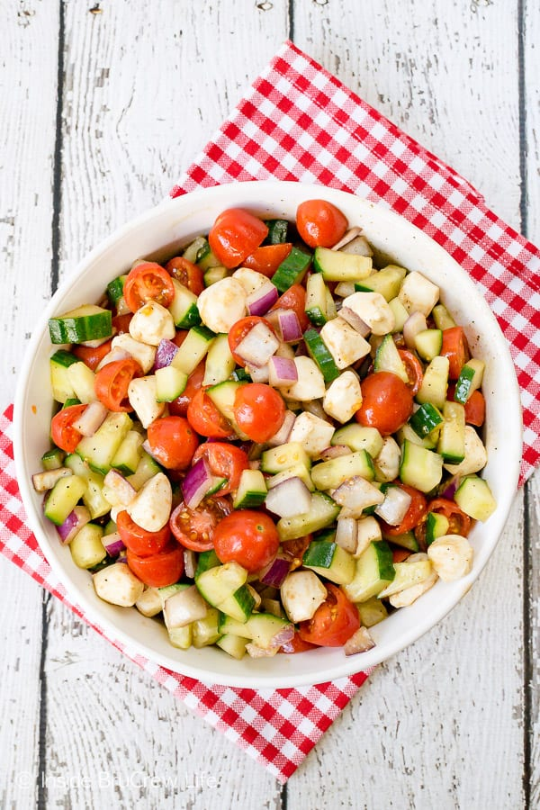 Balsamic Caprese Veggie Salad - a big bowl of this easy veggie salad is the perfect side dish to make for any meal. Try this healthy recipe all summer long. #salad #healthy #tomatoes #cucumber #picnic #sidedish #veggies #leanandgreen