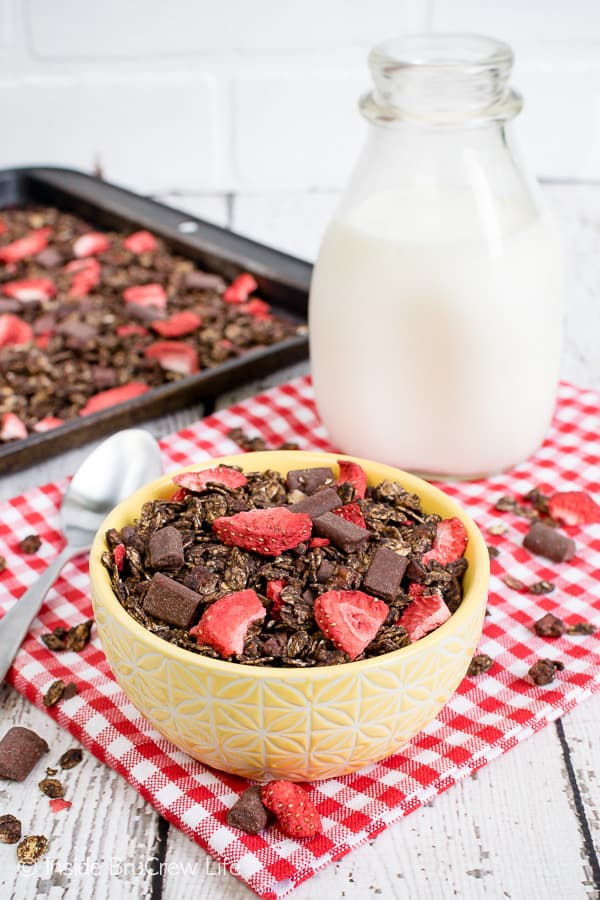 Chocolate Covered Strawberry Granola - this easy homemade chocolate granola is loaded with chocolate chunks and strawberries. It's delicious with milk or yogurt. Great recipe to try for breakfast or snacks. #homemade #chocolate #breakfast #snackmix #strawberry #afterschoolsnack #healthy #healthysnack