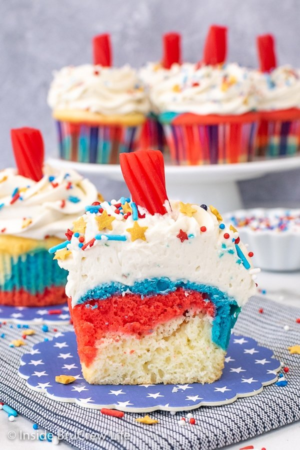 A red white and blue cupcake cut in half showing the swirls of colors inside.