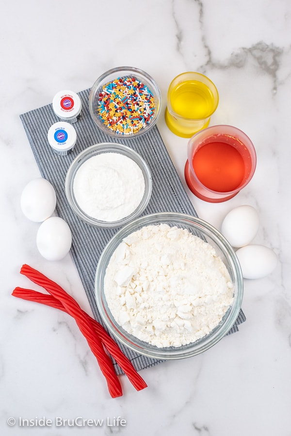 A white board with the ingredients needed to make Firecracker Cupcakes.