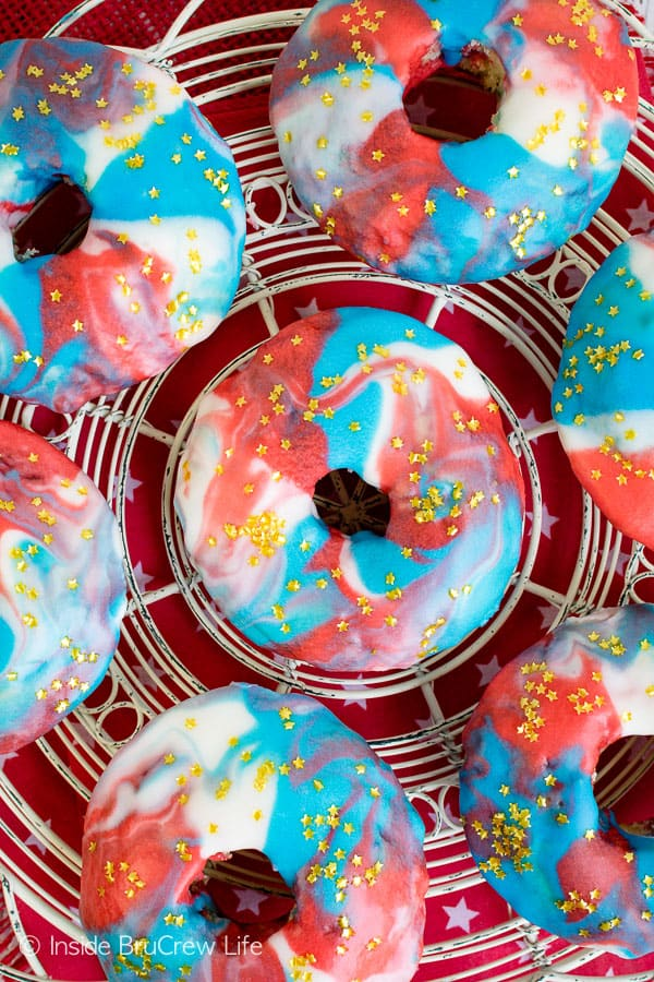 Patriotic Glazed Funfetti Donuts - gold star sprinkles and a red, white, and blue glaze make these donuts so fun. Make this recipe for Fourth of July mornings. #donuts #homemade #funfetti #redwhiteandblue #galaxydonuts #patriotic #4thofJuly #summer