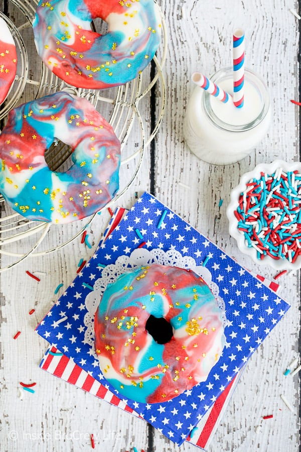 Patriotic Glazed Funfetti Donuts - a swirl of red, white, and blue glaze make these a fun summer breakfast. Make this recipe for the Fourth of July. #donuts #homemade #funfetti #redwhiteandblue #galaxydonuts #patriotic #4thofJuly #summer