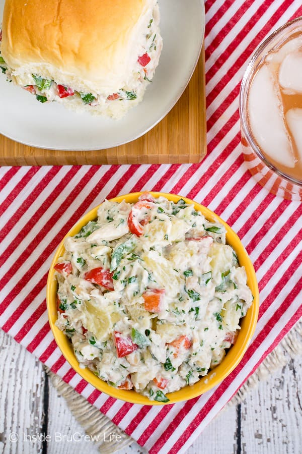 Hawaiian Chicken Salad - this healthy chicken salad is loaded with fruit, nuts, peppers, and Greek yogurt. Make this easy recipe for summer picnics and potlucks. #chicken #salad #healthy #dinner #picnicfood #easy #recipe #pineapple