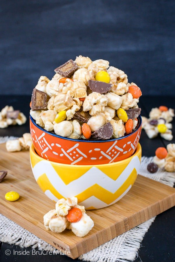 Salted Caramel Reese's Popcorn - this easy no bake snack mix has two kinds of Reese's candies, marshmallows, and sea salt. Try this sweet and salty recipe for your next movie night. #popcorn #saltedcaramel #peanutbuttercups #reesespieces #snackmix #nobake #sweetandsalty