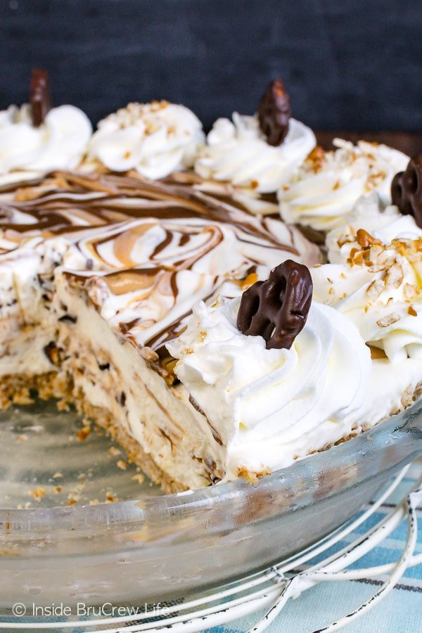Chubby Hubby Ice Cream Pie - a pretzel crust filled with homemade ice cream loaded with peanut butter and hot fudge is a great dessert. Try this easy recipe for hot summer days! #icecream #homemade #peanutbutter #chubbyhubby #pretzels #sweetandsalty #easy #recipe #pie #frozendessert #icecreampie