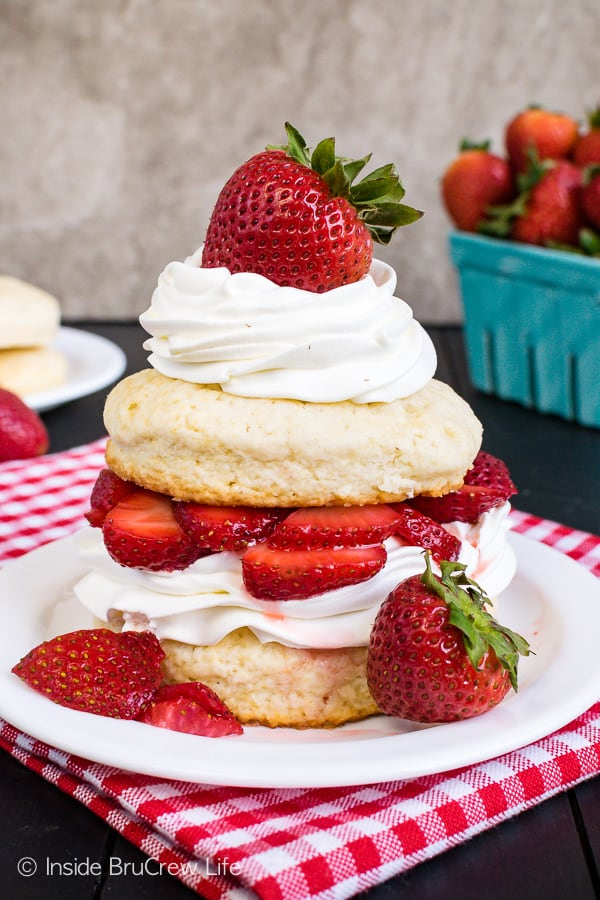 Homemade Strawberry Shortcake - layers of homemade shortcakes, fresh strawberries, and whipped cream makes an impressive dessert. Try this classic dessert recipe any time of year! #strawberry #shortcake #homemade #biscuits #summerdessert #recipe
