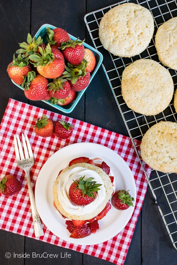 Homemade Strawberry Shortcake - sweet homemade biscuits layered with fresh strawberries and cream. This classic summer dessert is delicious any time of year! #strawberry #shortcake #homemade #biscuits #summerdessert #recipe