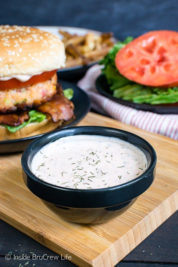 Homemade Cajun Shrimp Burgers - a creamy cajun dill sauce adds so much flavor to these homemade shrimp burgers. Try this recipe on a bun or a lettuce wrap! #shrimp #burger #healthy #dinner #recipe #cajun #homemade