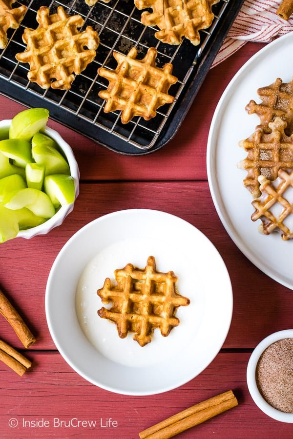 Mini Apple Fritter Waffle Donuts - dip these little apple treats in a sweet glaze for a fun fall treat. Easy recipe for breakfast or an after school snack! #apple #waffles #donuts #applefritters #fallsnacks #breakfast #afterschoolsnack #waffledonuts #crunchpak