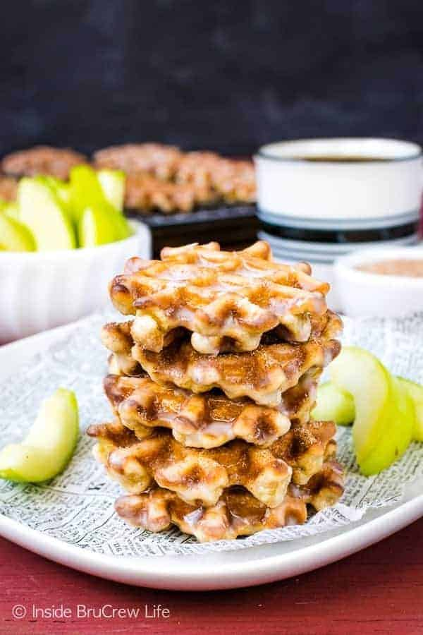 Mini Apple Fritter Waffle Donuts - shredded apples and a sweet glaze make these little waffle donuts a delicious snack. Make this easy fall recipe for breakfast or an afternoon snack. #apple #waffles #donuts #applefritters #fallsnacks #breakfast #afterschoolsnack #waffledonuts #crunchpak
