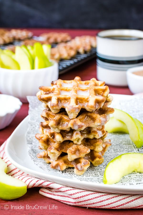 Mini Apple Fritter Waffle Donuts - these little waffle donuts are loaded with apples and dunked in a sweet glaze. Perfect little treat for after school snacks or breakfast this fall. #apple #waffles #donuts #applefritters #fallsnacks #breakfast #afterschoolsnack #waffledonuts #crunchpak