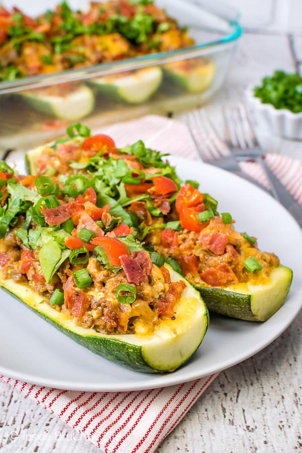 Bacon Cheeseburger Stuffed Zucchini - enjoy a healthy low carb meal that is stuffed with meat, cheese, and veggies. Try this easy recipe for dinner when you are staying on track with meals. #zucchini #cheeseburger #bacon #healthy #leanandgreen #recipe #dinner