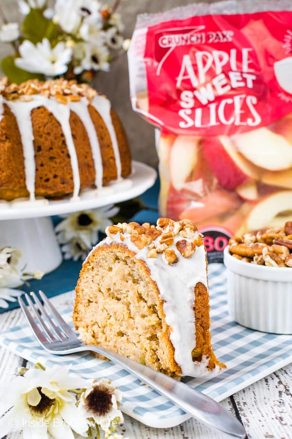 Chai Spiced Apple Bundt Cake - chai spices jazz up this soft apple cake and a glaze and pecans make it so pretty! Try this easy recipe for fall parties! #cake #apple #chai #bundtcake #homemade #crunchpak #fall #recipe