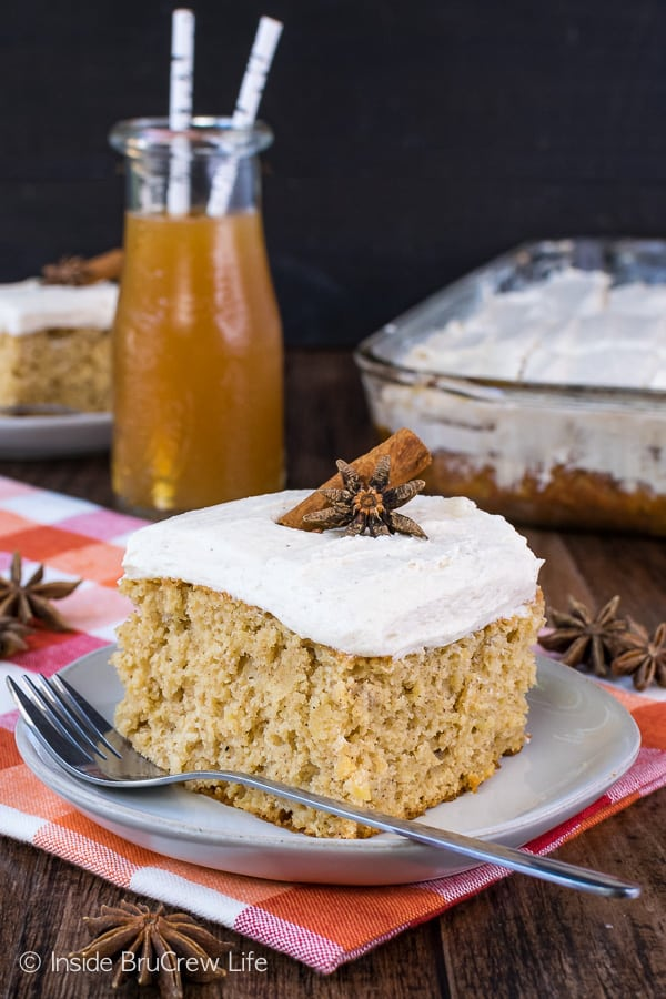 Apple Cider Cake - this sweet fall cake is loaded with apples, apple cider, and spices. It's a delicious recipe to bring to fall parties and events. #cake #apple #applecider #frosting #spicecake #cakemix #fall #recipes #doctoredcakemix