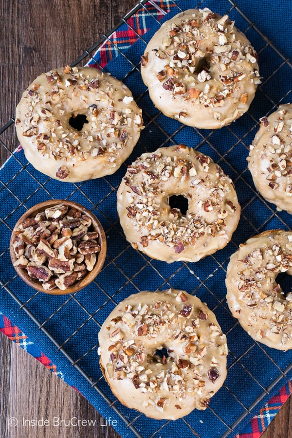 Apple Praline Donuts - soft baked donuts topped with a sweet praline glaze and pecans makes a delicious breakfast treat. Try this recipe on a cool fall day! #donuts #apple #pecans #praline #homemade #bakeddonuts #fall #recipes #breakfast #brunch #afterschoolsnack