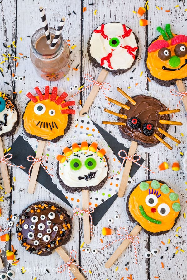 Make Your Own Monster Cookie Pops - decorate these simple chocolate sugar cookies with frosting, sprinkles, and candy to create fun monster cookies. Great activity for kids to do at Halloween parties! #sugarcookies #chocolate #frosting #halloween #milklife #ad #pourmoremilk #halloweencrafts #halloweentreats #halloweenparty #simpleingredients #cookiepops #partyideas