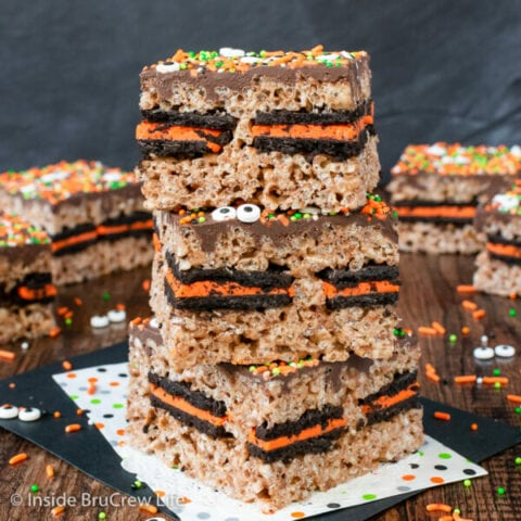 Three Oreo stuffed rice krispie treats stacked on top of each other.