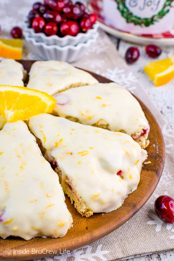 Glazed Cranberry Orange Scones - fresh cranberries and a sweet orange glaze makes these homemade scones taste amazing. Easy recipe for brunch or breakfast parties! #scones #cranberry #orange #breakfast #holiday