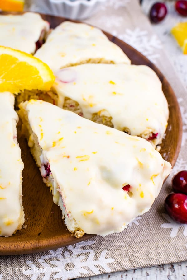 Glazed Cranberry Orange Scones - these easy homemade scones are loaded with fresh cranberries and topped with a sweet orange glaze. Great recipe to make for breakfast or brunch! #scones #cranberry #orange #breakfast #holiday