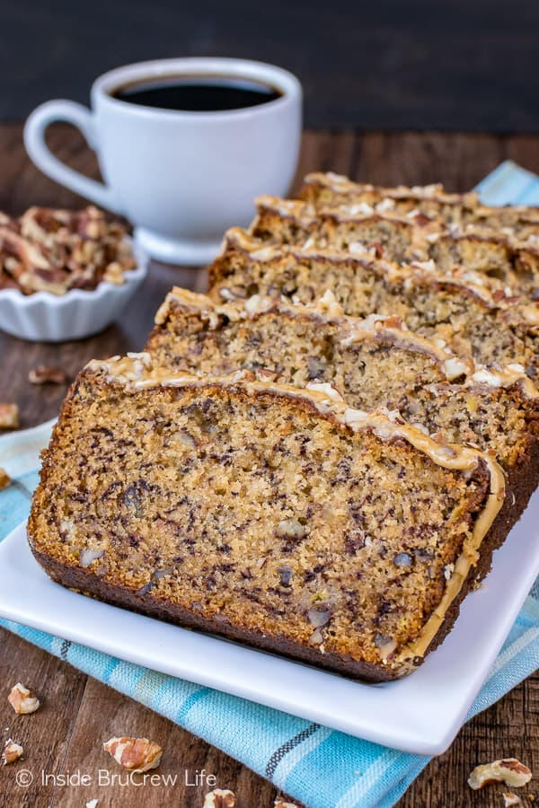 Maple Pecan Banana Bread - add a sweet twist to your classic banana bread by adding pecans and a maple glaze. This easy recipe will disappear in a hurry! #bananabread #maple #pecan #sweetbread #breakfast #banana #easy #recipe