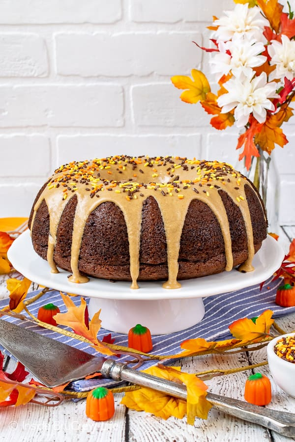 Pumpkin Spice Bundt Cake - a cinnamon maple glaze adds so much flavor to this homemade pumpkin cake! Make this easy recipe for fall dinners or parties! #bundtcake #dessert #fall #pumpkin #pumpkinspice #cake #thanksgiving
