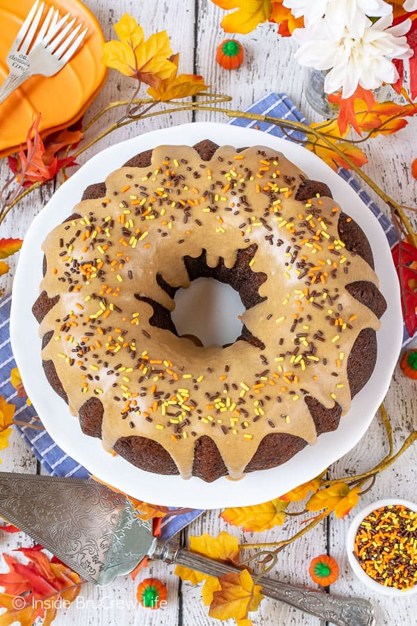 Pumpkin Spice Bundt Cake - this homemade pumpkin cake is loaded with spices and topped with a maple glaze that makes it taste amazing! Great dessert for fall parties or dinners! #bundtcake #dessert #fall #pumpkin #pumpkinspice #cake #thanksgiving