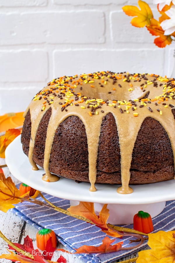 Pumpkin Spice Bundt Cake - lots of fall spices and a cinnamon maple glaze make this homemade pumpkin cake a delicious dessert. Make this easy recipe for fall parties or dinners! #bundtcake #dessert #fall #pumpkin #pumpkinspice #cake