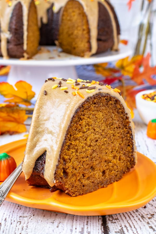 Pumpkin Spice Bundt Cake - this soft homemade pumpkin cake is full of fall spices and topped with a sweet maple glaze. It is the perfect recipe for fall parties or dinners! #bundtcake #dessert #fall #pumpkin #pumpkinspice #cake #thanksgiving