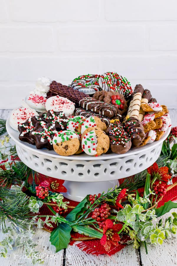 Decorating Store Bought Cookies - sprinkles and chocolate give store bought cookies a fun and easy decoration. Decorate these easy cookies when you do not have time to bake! #cookies #nobake #holiday #cookieexchange #easy