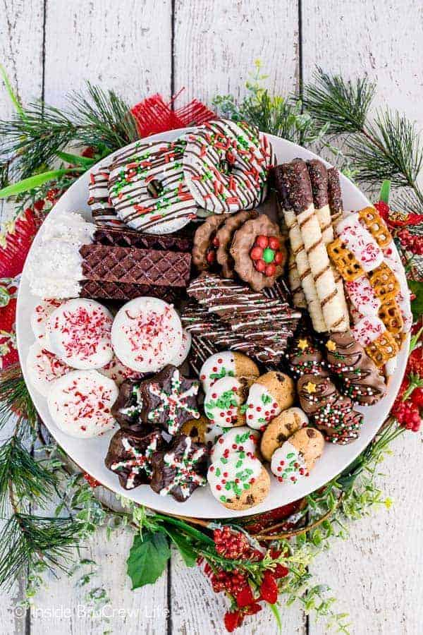 Decorating Store Bought Cookies - use melted chocolate and different sprinkles and candies to transform store bought cookies into fun and festive treats. Try these easy no bake cookies when you do not have time to bake. #cookies #nobake #holiday #cookieexchange #easy
