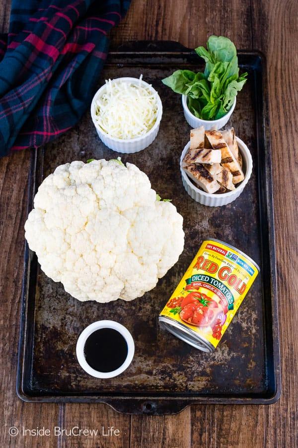 Chicken Caprese Cauliflower Nachos - transform cauliflower into a delicious skillet full of nacho goodness! #appetizer #cauliflower #healthy #nachos #gameday