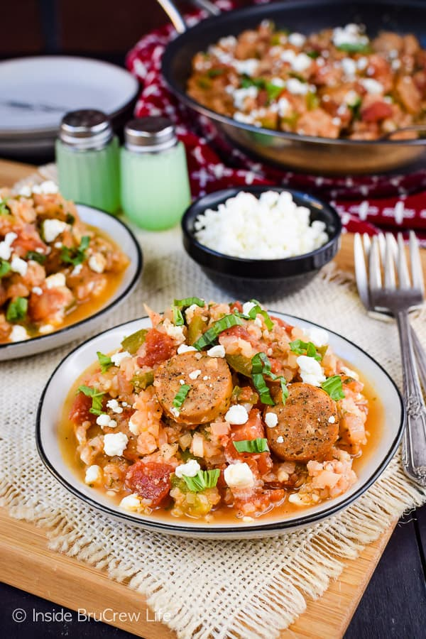 Tomato Basil Cauliflower Rice and Sausage - this easy one pan skillet meal is loaded with tomato basil cauliflower rice and chicken sausage. It's an easy and delicious meal that can be ready in minutes! #cauliflower #tomatobasil #leanandgreen #healthydinner #chickensausage