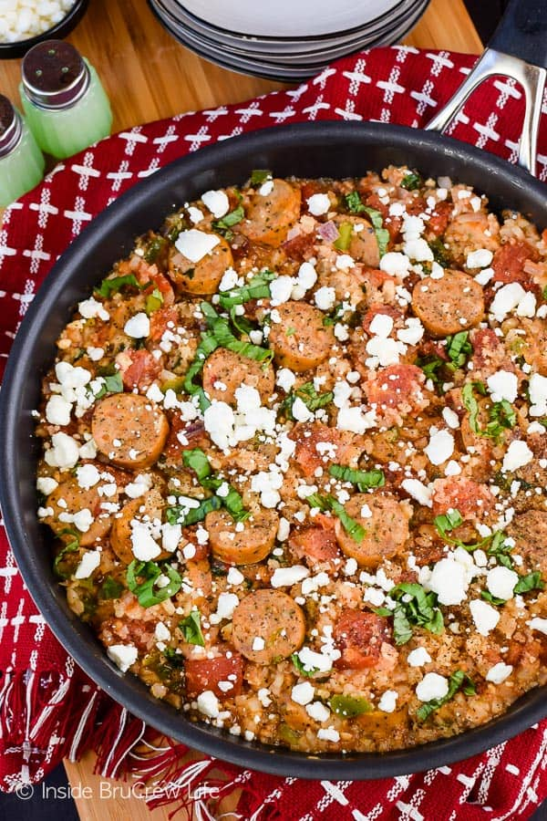 Tomato Basil Cauliflower Rice and Sausage - this easy one pan skillet dinner is loaded with tomatoes, basil, and sausage. It's a healthy and easy recipe that can be on the dinner table in under 30 minutes. #cauliflower #tomatobasil #leanandgreen #healthydinner #chickensausage