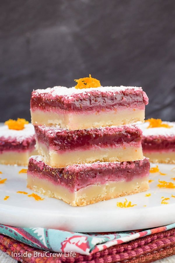 Blood Orange Bars - using blood orange juice and some coloring makes these vibrant orange bars so pretty and delicious. Make this easy recipe for spring parties! #orangebars #orange #bloodorange #spring #dessert