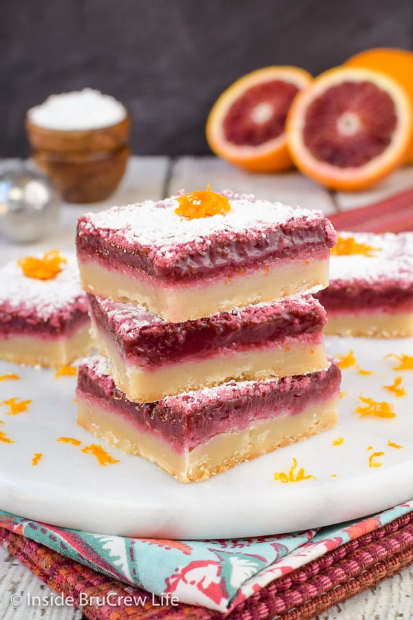Blood Orange Bars - the bright orange filling and shortbread crust make these orange bars so delicious! Try this easy recipe for spring parties! #orangebars #orange #bloodorange #spring #dessert
