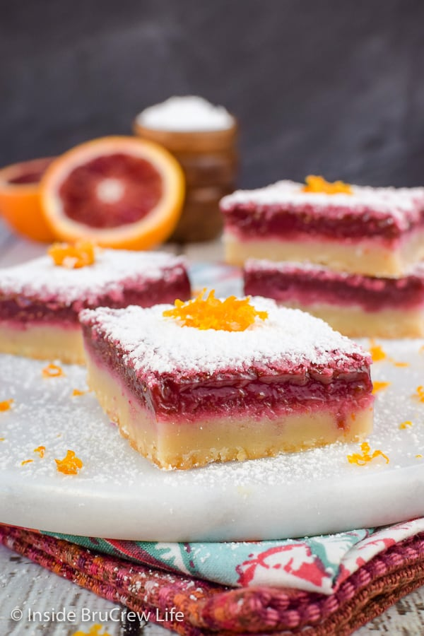 Blood Orange Bars - a buttery shortbread crust and a vibrant red filling makes these orange bars taste delicious. Great recipe to make for spring dessert parties! #orangebars #orange #bloodorange #spring #dessert