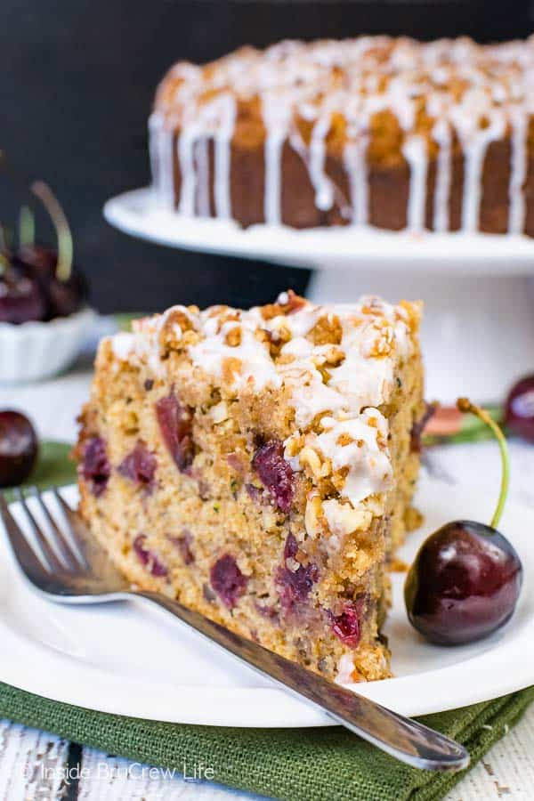 Cherry Zucchini Coffee Cake - fresh fruit and veggies make this coffee cake so good. The crumble and glaze make it even better! #coffeecake #cherry #zucchini #breakfast #brunchrecipes